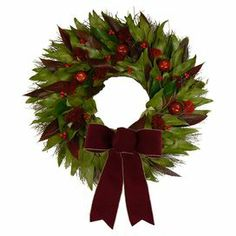 """Preserved leaf, cedar, and red eucalyptus wreath with faux berry and apple accents. Features a burgundy bow and natural twig base.  Product: WreathConstruction Material: Silicone and natural twigColor: Green and redDimensions: 22"""" Diameter x 4"""" DCleaning and Care: Avoid sunlight and humidity. Wipe gently with a dry cloth."""