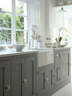 (better than child locks) I am really loving the look of these gray painted cabinets and the door clasps. I don't know if you are redoing cabinets, but I thought of you when I saw these as you have pinned a lot of beautiful grey schemes.
