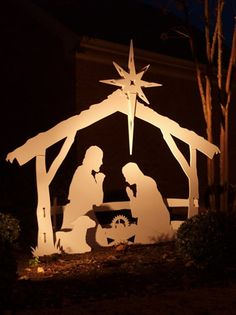 A Large, Beautifully Done Wood Cut Outdoor Nativity Scene With Soft Flood  Light Illumination.