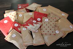 really cute idea for advent gifts.  took paper bags and sewed around it.  The idea is in a blog and you have to search back to November 27th to find it but it is such a cute idea!