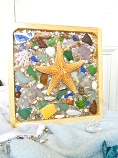"""""""Handmade Beach Glass & Sea Shell Wall Decor Wooden Panel One of a Kind""""-- Max would love this on his wall. From Etsy."""