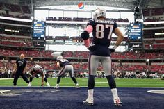 New England Patriots vs. Dallas Cowboys - Photos - October 11, 2015 - ESPN  -  ht end Rob Gronkowski #87 of the New England Patriots warms up on the field before the NFL game against the Dallas Cowboys at AT&T Stadium on October 11, 2015 in Arlington, Texas. (Photo by Christian Petersen/Getty Images)