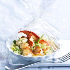 Découvrez la recette Papillote de homard et Saint-Jacques au Champagne sur cuisineactuelle.fr.
