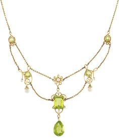 Antique Gold, Peridot and Freshwater Pearl Swag Necklace.  14 kt., one emerald-cut & one pear-shaped peridots ap. 9.15 cts., c. 1900, ap. 7.5 dwts. Length 18 1/2 inches. Via Doyle New York.