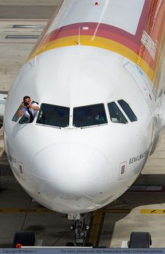 Iberia Airbus A320-214 EC-JSB at Barcelona. Who is photographing who?