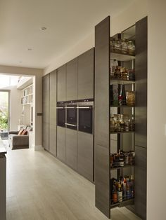 Snug Kitchens, Newbury. Pronorm YLine kitchen with Rift Oak Dark Décor tall and mid units.