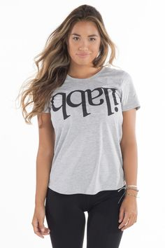 Make that statement in ilabb's signature Capsize tee. Featuring a bold-font print and an easy scallop back hem, you'll want to rock this for all your outdoor activity. Print Fonts, Scalloped Hem, Tomboy, Activewear, Workout, Tees, Fabric, Cotton, Collection