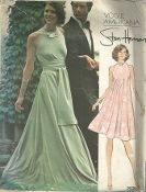 An original ca. 1973 Vogue Pattern 2976.  Stan Herman - Misses' Loungewear. Bias pull-over tent dress in mid-knee or evening length has jewel neckline, back slit with button and loop closing and cut-away armholes. With or without straight grain sash holding in fullness at waistline. (Note: For easy stitching - side seams are not on true bias). Suitable for Knits.