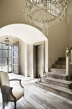 Simply Fab Living....the old wood used for floors and stairs, glass entrance.....this look is very appealing to me....!