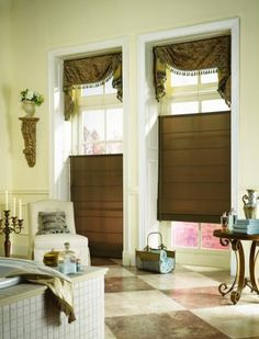 Top down/ bottom up roman shade accentuated with board mounted swag valance.