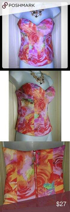 Guess Pink Tube Top Size Medium New Guess Pink corset style tube top size Medium. Fully lined, has padding in bust. Zips in back & has clasp to hold. Has boning on sides for that perfect silhouette. Beautiful top with floral design. Looks nice with jeans or shorts & heels for Summer!?  Across: 14 inches? Length: 13 inches? 94% Polyester, 6% Spandex Guess Tops