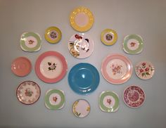 Arranged a combination of my favorite vintage and modern plates on the dining room wall. Love it!