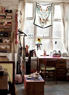 Hang a pretty scarf over a bright window.