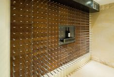 Wine cellars encased in glass and commercial glass wine cabinets with STACT wine racks are the most stunning way to display wine in modern homes and restaurants.