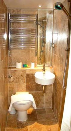 Small Wet Rooms - This is another small space solution. The bathroom (wet room)  floor has a drain and what looks like a 2-piece bath but it is a shower room too!