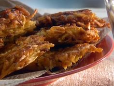 """Sunny Anderson's Bacon and Sage Potato Pancakes - One reviewer writes, """"This is by far my favorite potato pancake recipe. My whole family loves it and it is my standby now."""""""