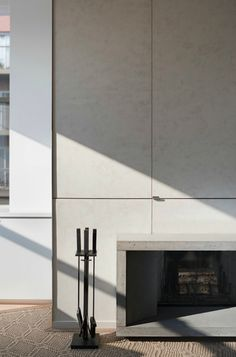 I really like the simplicity and elegance of this Minimalist Fireplace from Concrete by Leone Design Studio, Remodelista