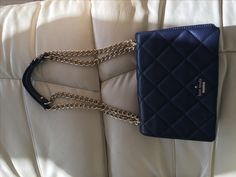 Kate Spade Cross Body Purse NAVY w Gold Chain - Never Used, Thought it was black when buying it.  I have the bone and fuchsia bags and get compliments on them.  Excellent for travel and cross body use. Also pulls twice for shorter needs.   Emerson Place Vivenna Mini Crossbody Bag