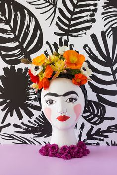 As you all know by now we love flowers and Frida Kahlo! We have combined the two into a vase! Flowery and unique!