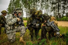 U.S. and Canadian soldiers plan their route through a forest during Ex Sabre Strike June 16 2014 [2048  1363]