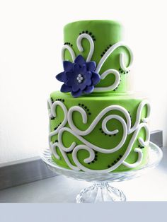 Green and purple wedding cake with swirlies. This is the first cake I've seen and really liked! Of course I'd replace the purple with blue :-)
