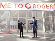 Oilers owner Daryl Katz, left, and Edmonton Mayor Don Iveson prepare to pull the banner down during the opening ceremony at Rogers Place Arena on Sept. 8, 2016.