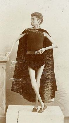 """Living Skeleton Boy (early 1900) cabinet card. Skeleton boys were """"fasting"""" exhibitions or """"hunger artists"""" meaning they would starve themselves to gain a startlingly thin appearance."""