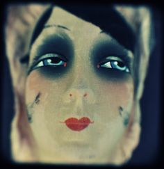 Mask from the 1920s. It was made in Germany from multiple layers of muslin, fabric and paint. Image c. Crafty Dogma