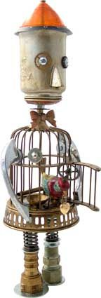 "Name: Finchley  D.O.B.: 10/20/11  Height: 16.5""  Principal Components: Birdcage, toy coffee pot, car signal lens, cabinet pulls, wind up bird, clock gears, valve springs, hydraulic fittings.  Amy Flynn Designs."