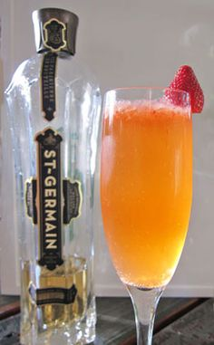 Lady Germain - lemon juice, strawberry, St. Germain elderflower liqueur, champagne, gin.