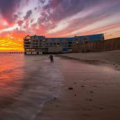 The sun sets on a fisherman on Strand Beach in the Western Cape. via Bryn De Kocks. House By The Sea, My House, Sun Sets, South Africa, Westerns, Cape, Celestial, Beach, African