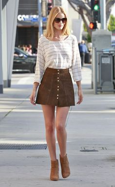 Rosie Huntington-Whiteley looks effortlessly chic in a white striped top, A-line suede skirt and cognac ankle booties.