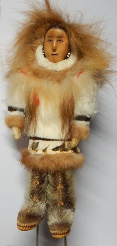 Vintage Inuit Eskimo Doll, with fur, wood. Very collectible. Wood faces.  The hand sewn face and body has amazing details, revealing clothes endemic