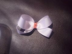 Basic white bow with a hint of orange