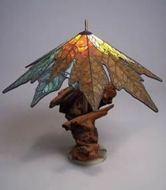 Love this leaf lamp! Ooh, I could make the base from clay and Carol could make the shade from stained glass!: Use idea to paint ceiling light cover. Stained Glass Lamp Shades, Stained Glass Light, Tiffany Stained Glass, Stained Glass Designs, Stained Glass Panels, Stained Glass Projects, Stained Glass Patterns, Cool Ideas, Diy Ideas