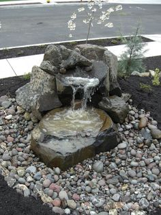A simple water feature using natural stones and #BeachStones for your #ResidentialLandscapeDesign