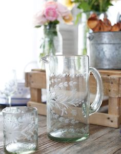 - Description - Artisan Mix up a batch of fresh lemonade in this pitcher. Beautiful hand-etched flowers and leaves add enchanting texture and dimension to the hand-blown recycled glass. * Approximatel