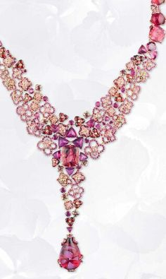 Chaumet Hortensia necklace in pink gold with rubies, pink sapphires, rhodolite garnets, red and pink tourmalines and a 25.68ct cabochon-cut pear-shaped red tourmaline drop. Chaumet Hortensia necklace in pink gold with rubies, pink sapphires, rhodolite garnets, red and pink tourmalines and a 25.68ct cabochon-cut pear-shaped red tourmaline drop.