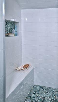 Upstairs Bath - Sliced Green pebble tile shower pan and shampoo niche.  https://www.pebbletileshop.com/products/Sliced-Sea-Green-Pebble-Tile.html#.VcpjdflViko