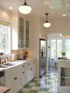 Nice green & white checkerboard flooring, brings good energy to this kitchen. Feng shui of colour green tips: http://fengshui.about.com/od/fengshuiuseofcolors/qt/fengshuigreen.htm