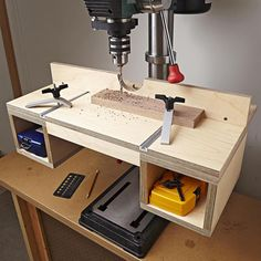 Do-it-all drill-press table woodworking plan. Instantly up your hole-making accuracy and convenience with this built-in-a-day attachment. This table features a top surface big enough to support large workpieces, an easy-to-adjust fence for repeatable accuracy, quick-action hold-downs, and accessory storage.