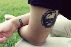 skull medallion  infinite tattoo