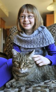 "Amanda Dolson, 10, (shown here with her cat, Winnie) was recently diagnosed with rheumatoid arthritis. She wants people to realize that arthritis ""isn't just an old person's disease."""