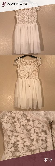 White Lace Flowered Dress The length of the dress is 30 inches long. The back is low but the length is addressed in the pictures. Dresses Midi
