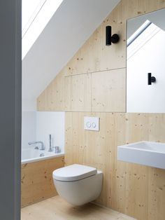 Wooden panels provide a contrast of warmth against the white walls and fixtures. 65 Most Popular Small Bathroom Remodel Ideas on a Budget in 2018 Attic Bathroom, Bathroom Toilets, Small Bathroom, Bathrooms, Bathroom Faucets, Modern Bathroom, Bathroom Wall Panels, Two Bedroom House, Warehouse Conversion