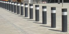 Scimitar 75/40 PAS68 Bollards crash tested static bollards are ideal to protect larger perimeters and provide a cohesive line of protection Glasgow Airport, Security Solutions, Paint Finishes, How To Level Ground, Facade, Larger, Paint Lamps, Facades