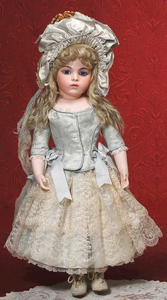Jumeau Bebe known as 'Portrait' - early model with original boutique label in antique costume. Image courtesy Frasher's Doll Auctions.