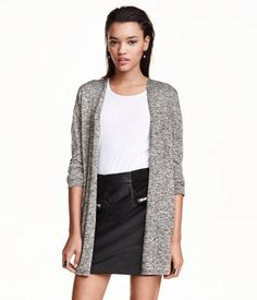 Wide-cut cardigan in a soft, fine knit with long sleeves, dropped shoulders, and no buttons.