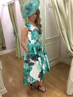 About Me: Sleeveless round neck dress with white background, green and black rose flower detail, full skirt just below the knee with dip hem to the back and bow Occasion Wear, Special Occasion Dresses, Black Rose Flower, Race Day, Fashion Boutique, Summer Wedding, Party Dress, Summer Dresses, Lady