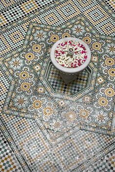 A traditional marble and zellij fountain from Riad La Sultana in Marrakech.